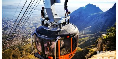 PICS AND VIDEO: LOCAL MOUNTAIN MAN COMPLETES A HANDSTAND ON TOP OF A CABLE CAR!